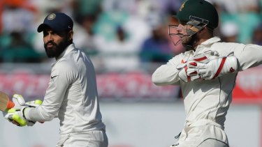 War of words: Ravindra Jadeja and Matthew Wade.