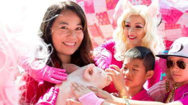 Valerie Khoo, curator of the Sydney Lunar Festival for the Lunar New Year with the Roving Pigs dancers from Dance Kool.