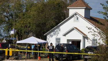 Law enforcement officials works at the scene of a fatal shooting at the First Baptist Church in Sutherland Springs, Texas.
