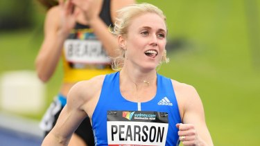 Sally Pearson celebrates after competing in the Open Womens Preliminary 100m Hurdles event.