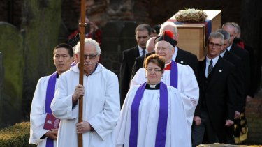 The coffin of Richard III emerges from the St Nicholas church in Leicester on Sunday.