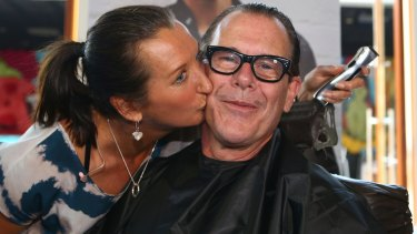 Former INXS guitarist Kirk Pengilly with his wife surfing champion Layne Beachley.
