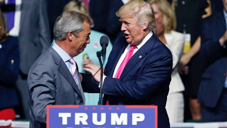 A meeting of like minds: Donald Trump welcomes Nigel Farage to the stage.