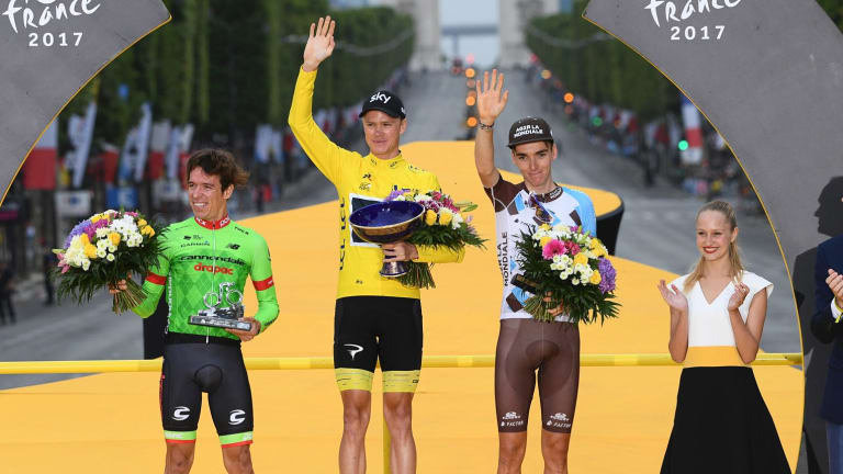 Biggest stage: Winner Chris Froome on the Tour de France podium last year, alongside Rigoberto Uran and Romain Bardet.