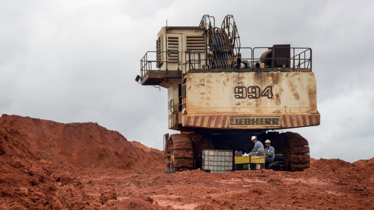 Iron ore advanced on speculation that China, the main destination for Brazil's metals and commodity exports, will restrict output.