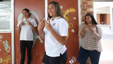 W for Walgett: Year 9 students Abbey Ashby, Raylene Kennedy and Shaneika Morgan from Walgett Community College.