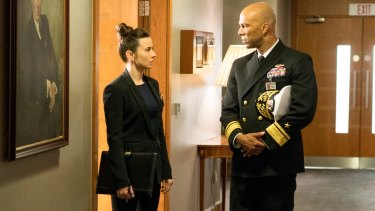 Linda Cardellini (left) and Common in the absorbing film that mixes underwater action with a Russian military coup and high-stakes debate in Washington.