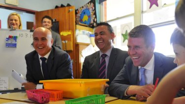 Education Minister Adrian Piccoli, Skills Minister John Barilaro (centre), and NSW Premier Mike Baird. The free TAFE scholarships have boosted course enrolments.