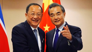 North Korean Foreign Minister Ri Yong Ho and his Chinese counterpart Wang Yi before their bilateral meeting at the ASEAN foreign ministers' meeting in Manila.