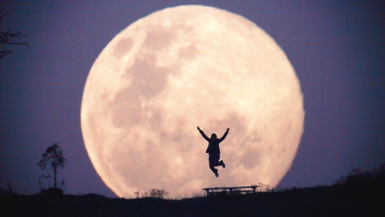 A supermoon rises over Canberra in 2014.