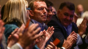 Former prime minister Tony Abbott observed from his front-row seat while several hundred members in the rows behind had his back.