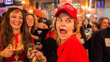 A Democrat wearing a 'Make America Great Again' hat and her friend dressed as Wonder Woman were celebating when Hillary Clinton won the state of Vermont.