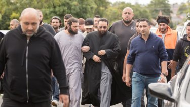 Sheikh Mohamad Abou Eid wears dark glasses as he walks to Preston Mosque before Friday prayers.