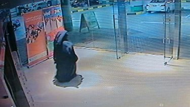 An image from video released by the Abu Dhabi police department in December last year shows a veiled suspect in the stabbing of an American teacher in a shopping mall restroom as seen on security camera footage in Abu Dhabi