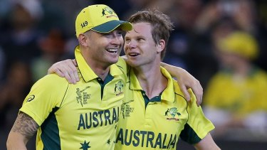 Local heroes: Michael Clarke and Steve Smith arm in arm after guiding Australia to victory.