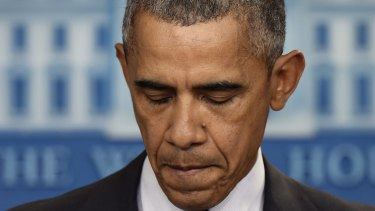 President Barack Obama pauses as he speaks about the shooting at the community college in Oregon.