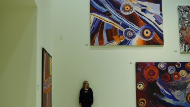 Sense of energy and activity: Curator Anne Ryan surrounded by paintings in the central exhibition gallery of the Art Gallery of NSW.
