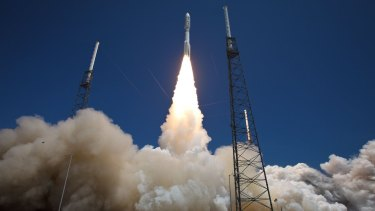 An Atlas V rocket blasts off on Wednesday carrying three Australian designed mini-satellites.