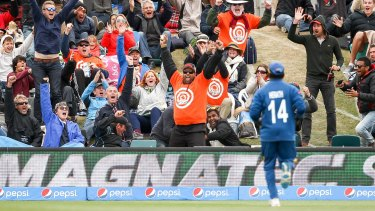 One in a million: A spectator (centre) took the catch in the World Cup opening match.