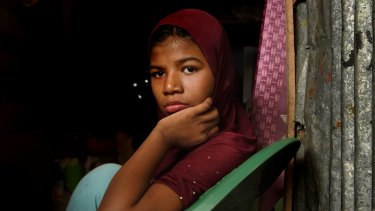Sumiya Begum, 12, was injured in a machete attack in Myanmar five years ago and has not spoken since. Her father was killed by Myanmar police.