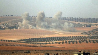 Smoke billows up on Syrian side of border.