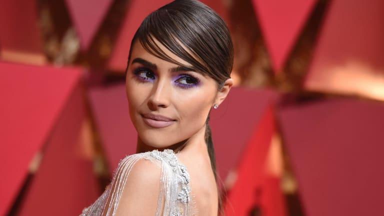 Olivia Culpo arrives at the Oscars last year.