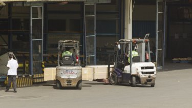 The coffins of Andrew Chan And Myuran Sukumaran on forklifts at Jakarta Airport.