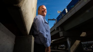 Melway director Murray Godfrey in the midst of  Melbourne's road network.