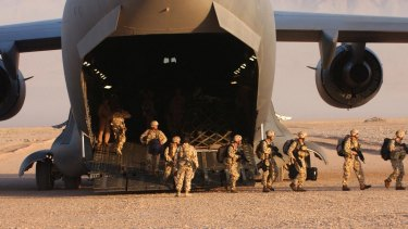 Members of the Australian Special Operations Task Group disembark a United States Air Force C-17 Globemaster at a base in Afghanistan.
