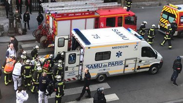 One of the wounded is taken into an ambulance outside the Louvre in Paris.