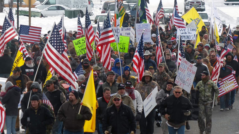 Protesters march in support of an Oregon ranching family facing jail time for arson in Burns, Oregon, ahead of the militant takeover of a federal building.