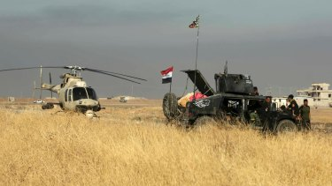 Offensive underway: an Iraqi military helicopter makes emergency landing outside Mosul.