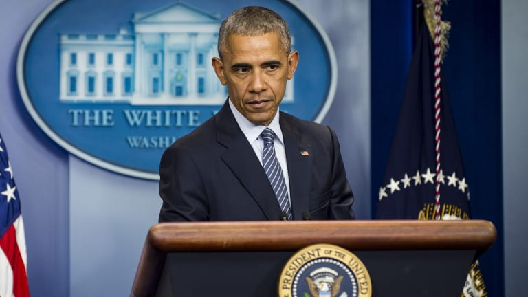 President Barack Obama listens to a question during a press conference at the White House.
