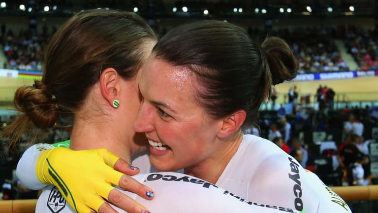 Rebecca Wiasak of Australia celebrates winning gold with bronze medalist Amy Cure.
