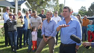 NSW Premier Mike Baird (near microphone) and Planning Minister Rob Stokes during a visit to Bulga in April.