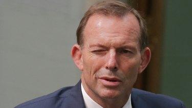 Former Prime Minister Tony Abbott winks leaving Question Time.