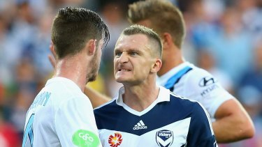 Connor Chapman of City and Besart Berisha of Victory exchange words during a derby last season.