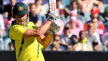 Glint-eyed: Marcus Stoinis hits a pull shot against England.