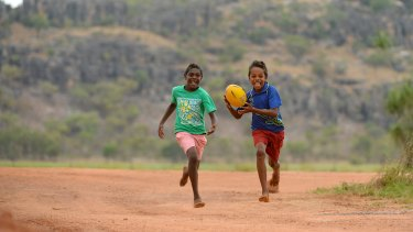 Aboriginal children playing footy at the Gunbalanya School in Arnhem Land.