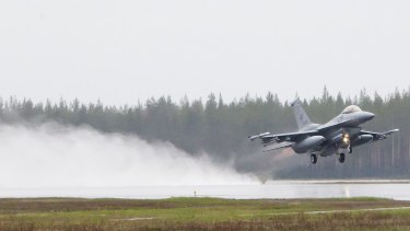 A US F-16CM fighter takes off from Kallax Airport outside Lulea, in northern Sweden, during the Arctic Challenge Exercise.