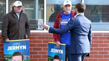 Opposition Leader Bill Shorten's media adviser Sam Casey advises the Liberal candidate for McEwen, Chris Jermyn, that if he did want to meet Opposition Leader Bill Shorten, he was standing at the wrong entrance.