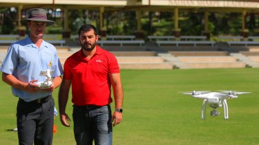 The Southport School Year 12 student Cormac Kennedy-Leverett and Westpac Little Ripper chief operations officer Ben Trollope fly a drone at the school on Wednesday.