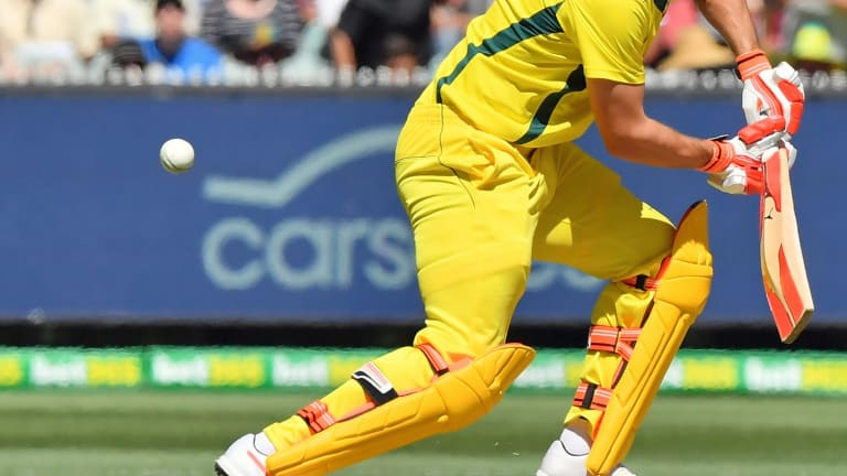 New lease on life: Mitchell Marsh guides the ball  away at the MCG.