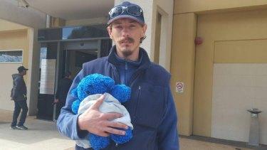 """Heartbroken"": Nikki's father Nicholas Coslovich, holding her favourite toy."