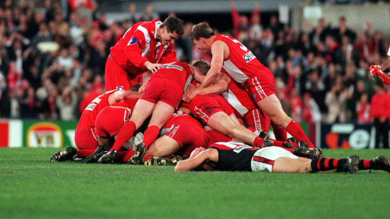 John Orchard (standing on the left) celebrates with players after Tony Lockett put the Swans into the 1996 grand final.