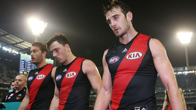 Michael Hibberd (centre) has told Essendon he wants to leave.