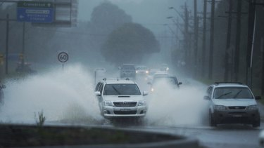 Heavy rain caused flooding across Castlereagh Road in Cranebrook on Tuesday.