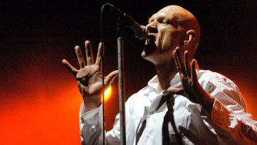Midnight Oil frontman Peter Garrett says the money paid for playing at the Domain goes to the Botanic Gardens Trust, which uses it for 'education, science and horticulture'.