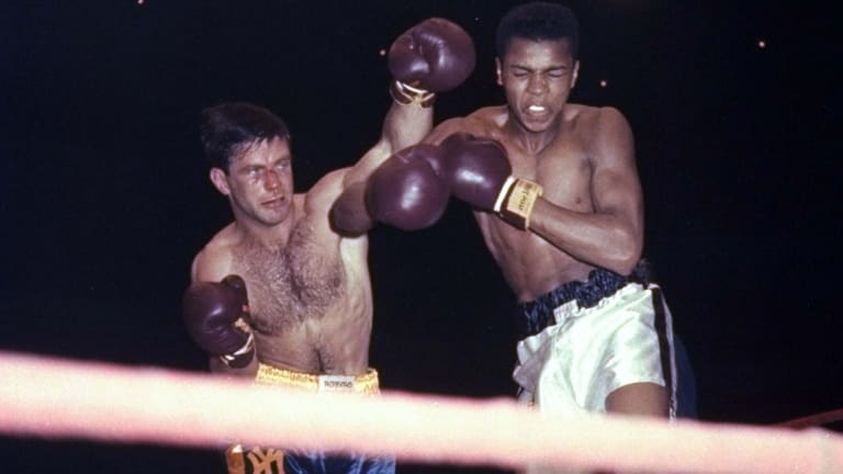 Lasting impression: Tony Madigan fighting Muhammad Ali, then known as Cassius Clay, in 1959.