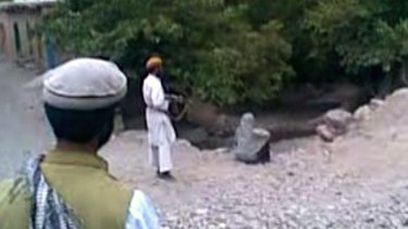 Brutality: Taliban fighters execute a woman, reputed to be the wife of one of their members, for adultery in footage from Parwan province in July 2012.